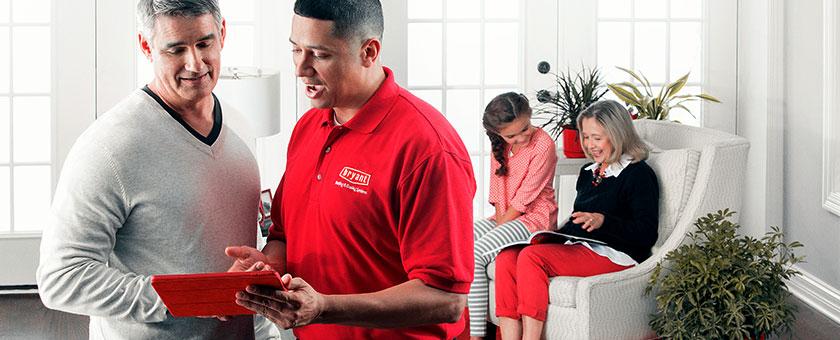 HVAC technician discussing home comfort